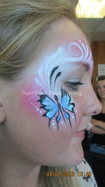 student face art swirly butterflies