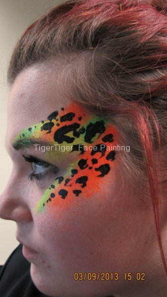 student face art uv leopard