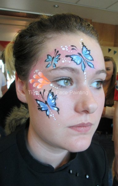 student face painting butterflies
