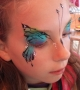 blue sparkly butterfly face paint, teen face painting