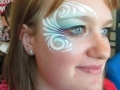 adult face painting swirly eye design