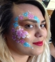 pink and turquoise flowers adult face painting