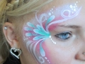 student face art swirly flowers