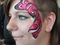 teen face painting funky bow design