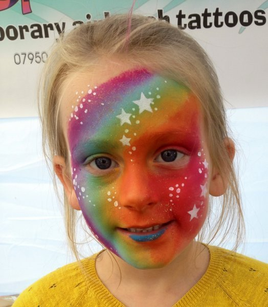 rainbow with stars face paint design
